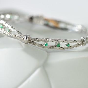 Bracciale 'Unoaerre' anni'70  oro bianco e smeraldi