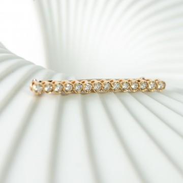 Spilla 1960 oro giallo e diamanti